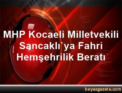 MHP Kocaeli Milletvekili Sancaklı'ya Fahri Hemşehrilik Beratı